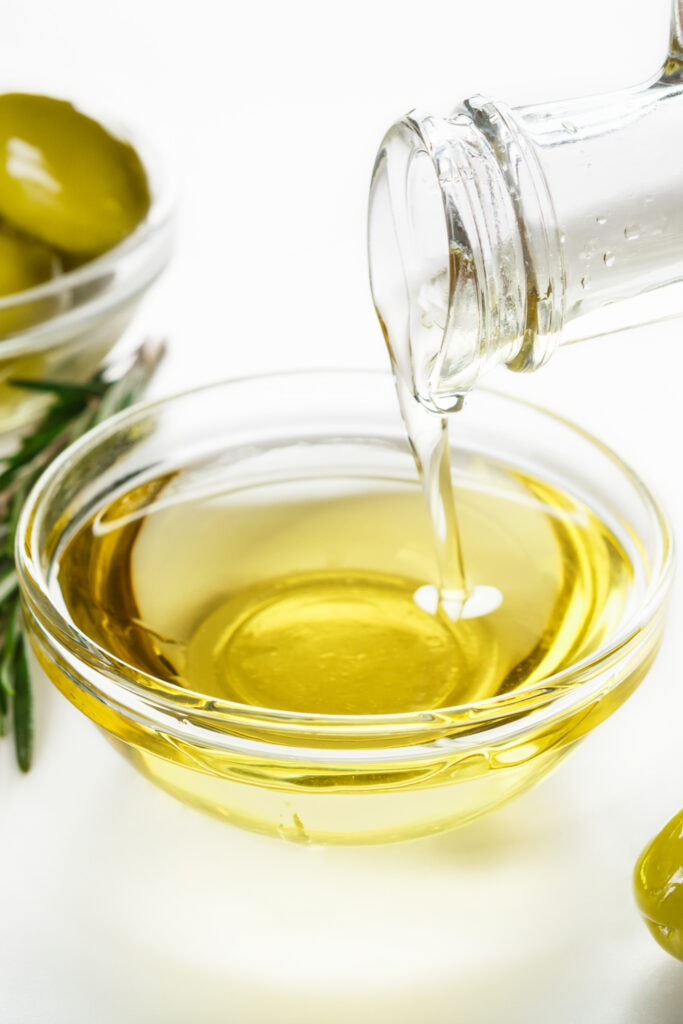 Pouring Olive Oil in a Small Container